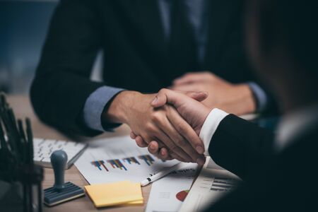 Two confident business man shaking hands during a meeting in the office, success, dealing, greeting and partner concept. Foto de archivo - 139420445