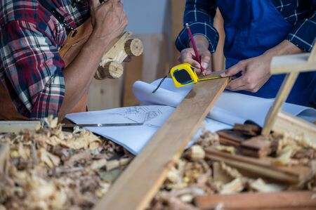 Professional carpenters are teaching carpentry to a new generation.