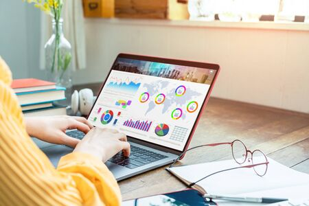 Young woman using a laptop computer. Graphic designer. UX design.