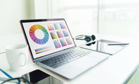Graphic design concept. Laptop computer in office. Color Management.