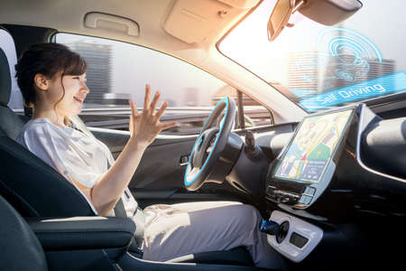 young woman riding autonomous car. self driving vehicle. autopilot. automotive technology.