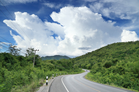 highroad: Long and winding road with clouds and blue sky