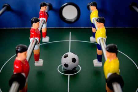 football table game with yellow and red players Stock Photo