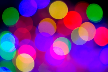 Defocused bokeh image of colorful christmas fairy lights photo