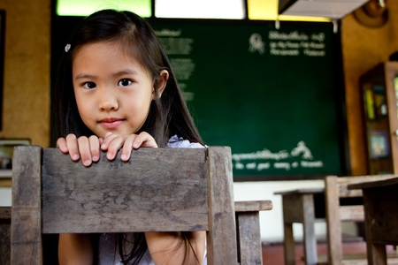 Little Asian girl in the classroom photo