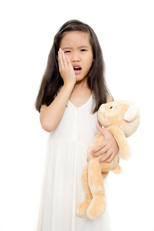Little girl with toothache action isolated on white background Stock Photo