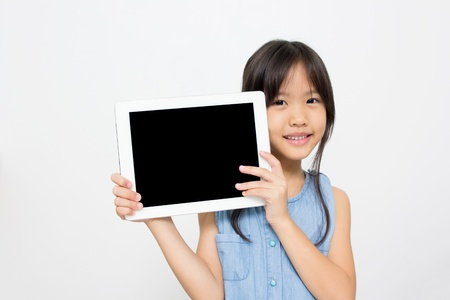 Happy Asian child with tablet computer Stock Photo - 21934742