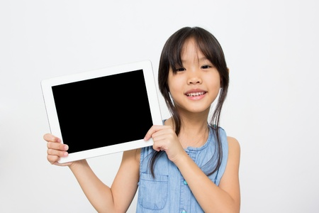 Happy Asian child with tablet computer Stock Photo - 21934743