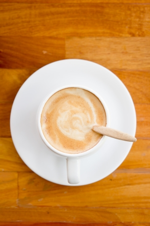 A cup of coffee on wooden background  Stock Photo