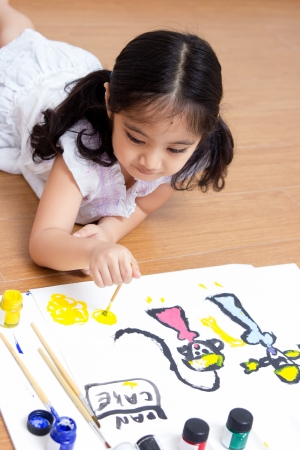 Little Asian artist child drawing and painting Stock Photo - 22419972