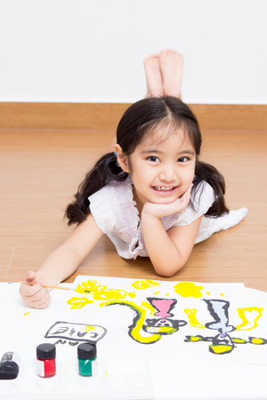 Little Asian artist child drawing and painting
