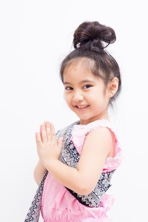 Liitle Asian child welcome expression Sawasdee  Фото со стока