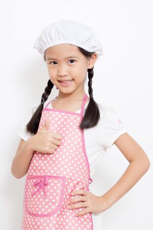 Pretty Asian cute chef wearing pink apron and thumb up