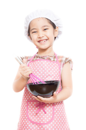Happy little Asian cute chef wearing pink apron