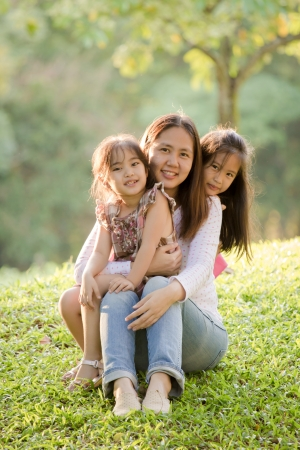 Happy Asian Mother and daughter in park photo