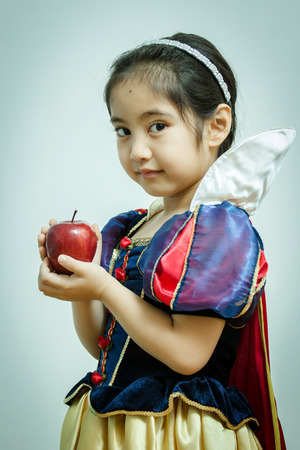 Fantasy vintage of the beautiful Snow White with an apple photo