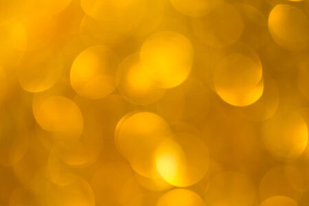 Abstract defocused gold bokeh background