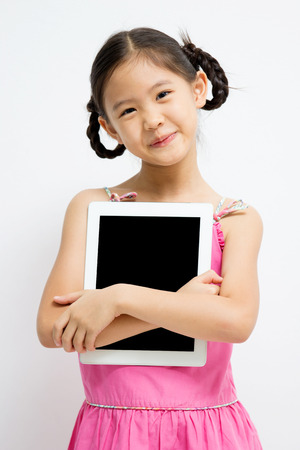 Happy Asian girl with tablet computer