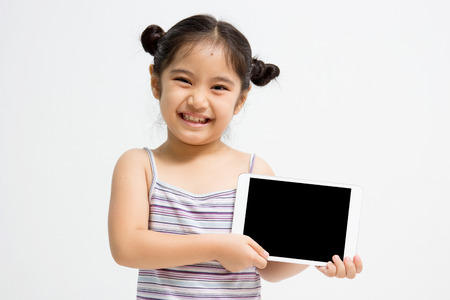 Happy Asian girl with tablet computer photo