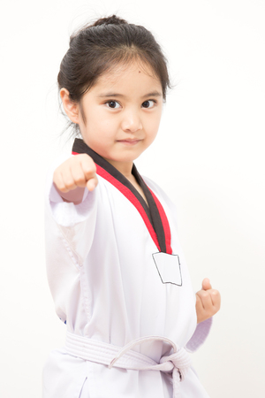 Little asian child in fighting action photo