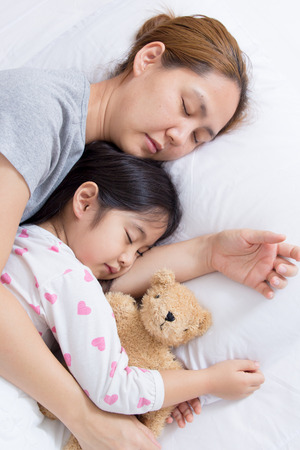 Sleeping Asian child and mother photo