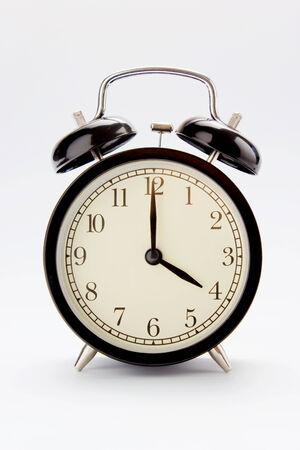 Classic alarm clock at 4 O clock Imagens