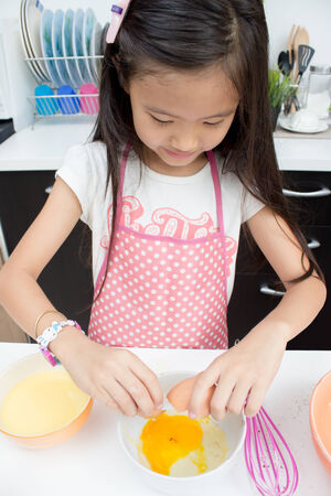 Asian child preparing for bakery photo