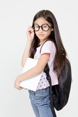 A portrait of an Asian preschool student