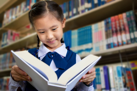 Asian little student in library Stock Photo - 29642811
