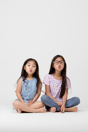 Portrait of little cute Asian girl with funny face