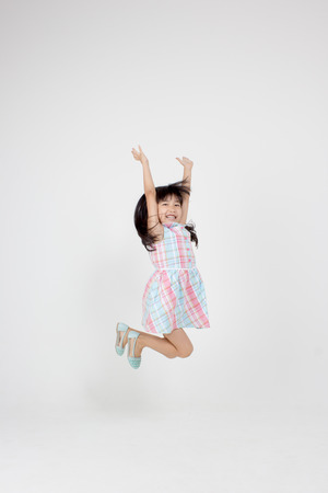 Portrait of happy little Asian child jumping