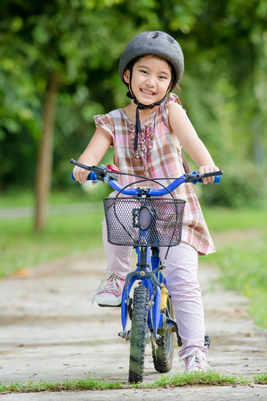 Little Asian child with bicycle
