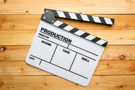 Movie slate film on wooden table Stock Photo - 33879041