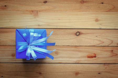 Blue gift box for new year on wooden background