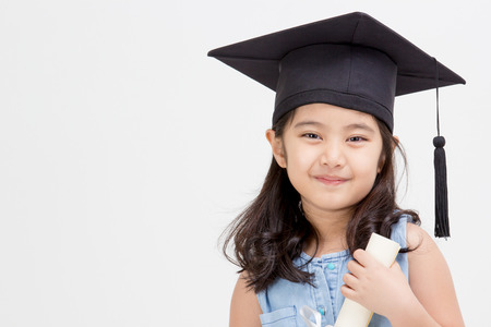 Happy Asian school kid graduate in graduation cap Stock Photo - 37167025