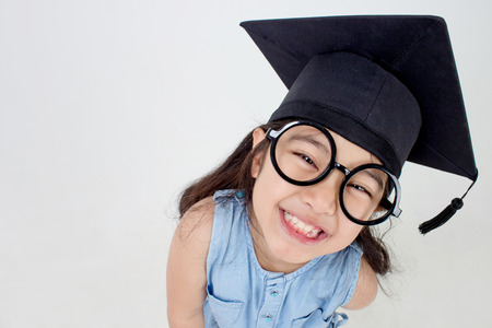 Happy Asian school kid graduate in graduation cap with copy space Stock Photo - 35114175