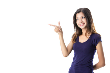 Pretty Asian girl smiling and point finger on isolated background Stock Photo - 36059491