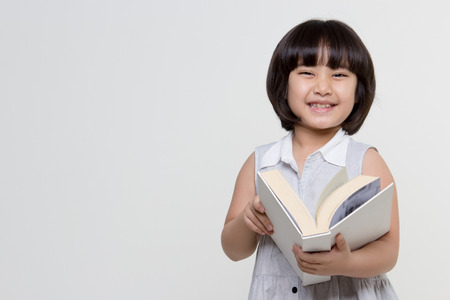 Portrait of little lovely Asian child reading a book Stock Photo - 39229370