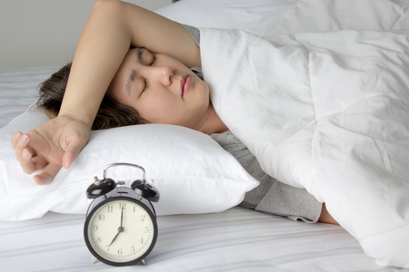 woman with clock: Sleepless Asian young woman Stock Photo