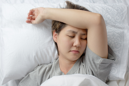 Sleepless Asian young woman 스톡 콘텐츠