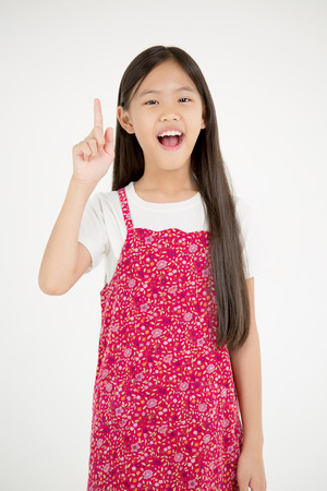 child finger: Portrait of happy little Asian child finger up on isolated background Stock Photo