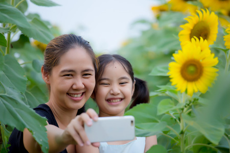 Asian mother and daughter taking selfie photograph together Stock Photo - 49215793