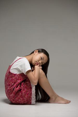 darkroom: Lonely Asian child in the darkroom