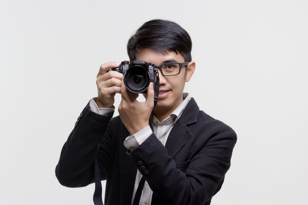 Asian photographer with camera on isolated background 스톡 콘텐츠