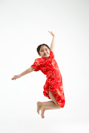 female kid: Happy Asian family jumping on Chinese new year