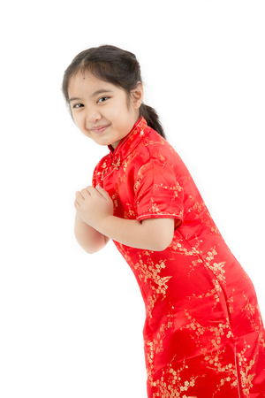 wishing: Little Asian girl wishing you a happy Chinese new year on isolated
