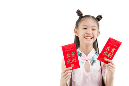 tradition: Happy Asian Chinese child showing Chinese new year red paper packet gift on isolated Stock Photo