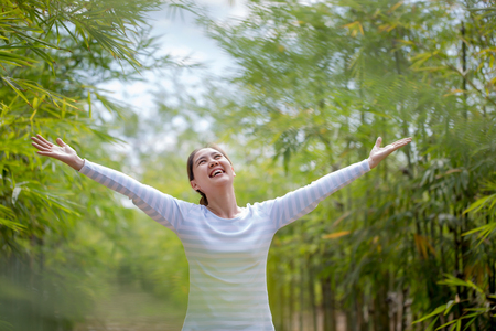 asian natural: Beautiful Young Asian Woman Enjoying Nature. Healthy Smiling Girl in Green Bamboo Forest.