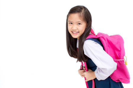 back packs: Portrait of asian child in school uniform with school bag on white background isolated