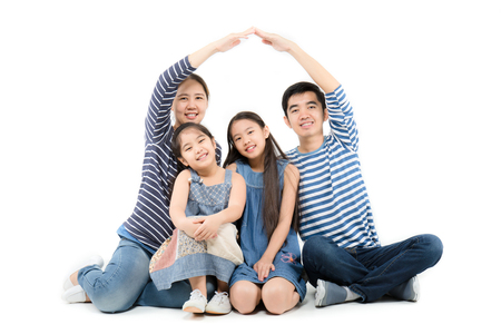 Asian family smiling and playing house by hands on isolated white background Stock Photo